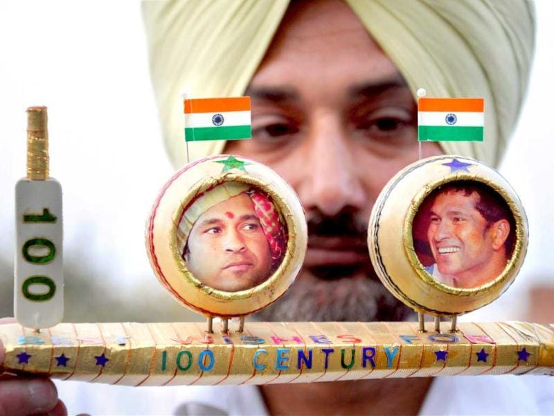 Miniature artist HS Gill showing his creation on cricketer Sachin Tendulkar to celebrate his 100th century, in Amritsar on Friday. PTI Photo