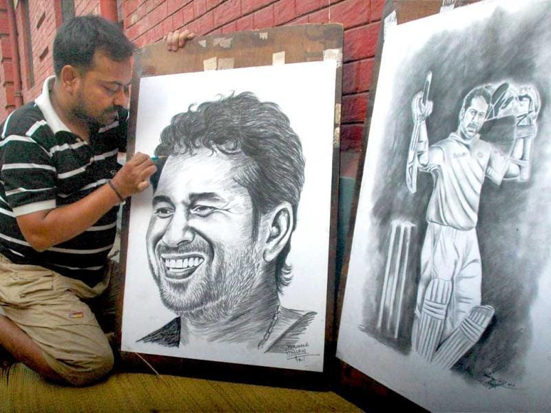 Painter Ramjan Ali gives finishing touch to a painting of cricketer Sachin Tendulkar to greet him for his 100th ton, in Kolkata. PTI Photo