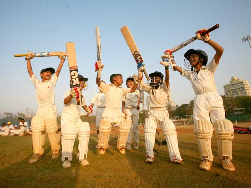 Young cricketers celebrate in Sachin's home town Mumbai as the cricket legend scores his 100th century in a One Day International at Sher-e-Bangla Stadium, Dhaka, Bangladesh. HT Photo/Kalpak Pathak.