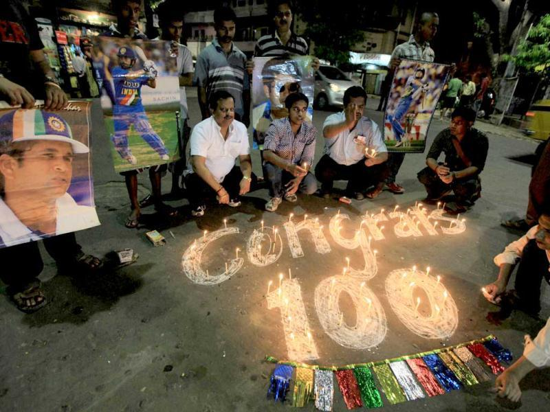 Fans celebrating the 100th century of master blaster Sachin Tendulkar in Kolkata on Friday. PTI Photo