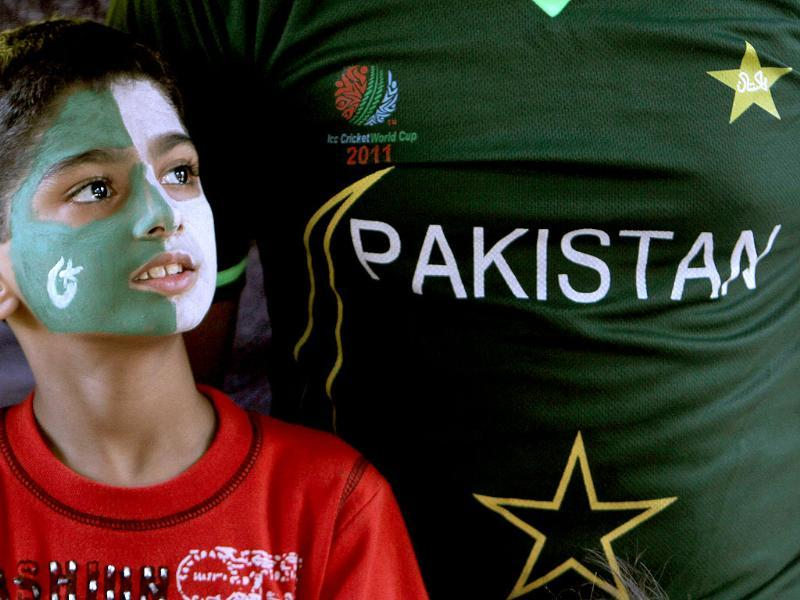 A youngster reacts as he watches the Asia Cup cricket match between Pakistan and India on a huge screen in Karachi, Pakistan. AP photo