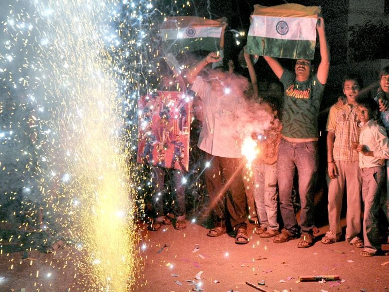 Cricket fans celebrate India's victory over Pakistan in the Asia Cup, in Ahmedabad. PTI photo