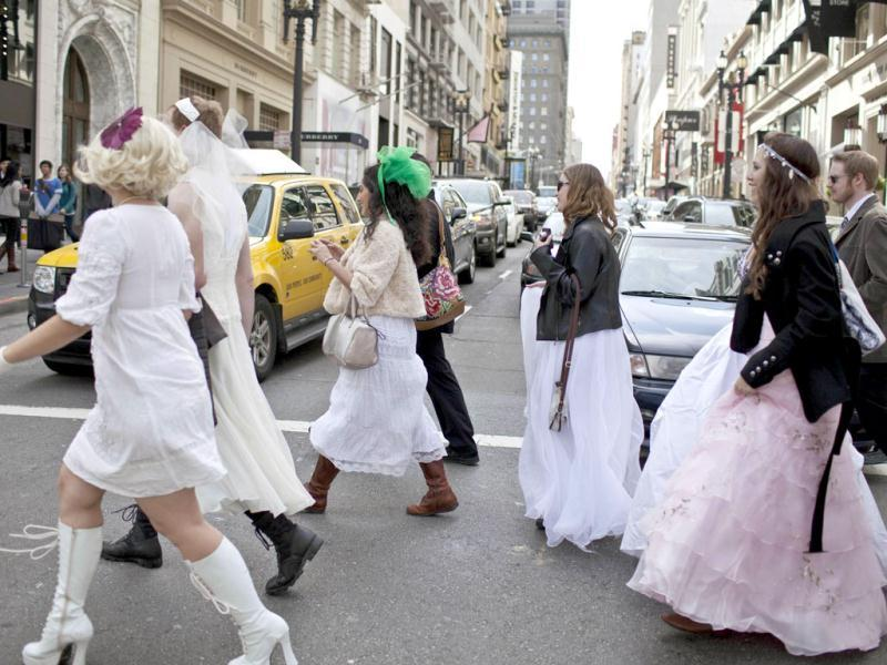 Participants dressed in wedding outfits take part in the March of Brides parade. Reuters/Jana Asenbrennerova