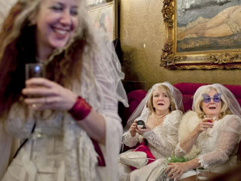 Participants, dressed in bridal outfits, drink champagne during the March of Brides parade through downtown San Francisco. Reuters/Jana Asenbrennerova