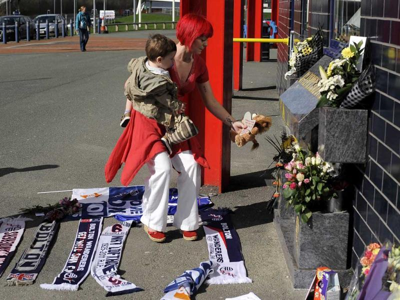 A well-wisher lays a soft toy with a message to Fabrice Muamba at the Reebok stadium in Bolton. Reuters/Nigel Roddis