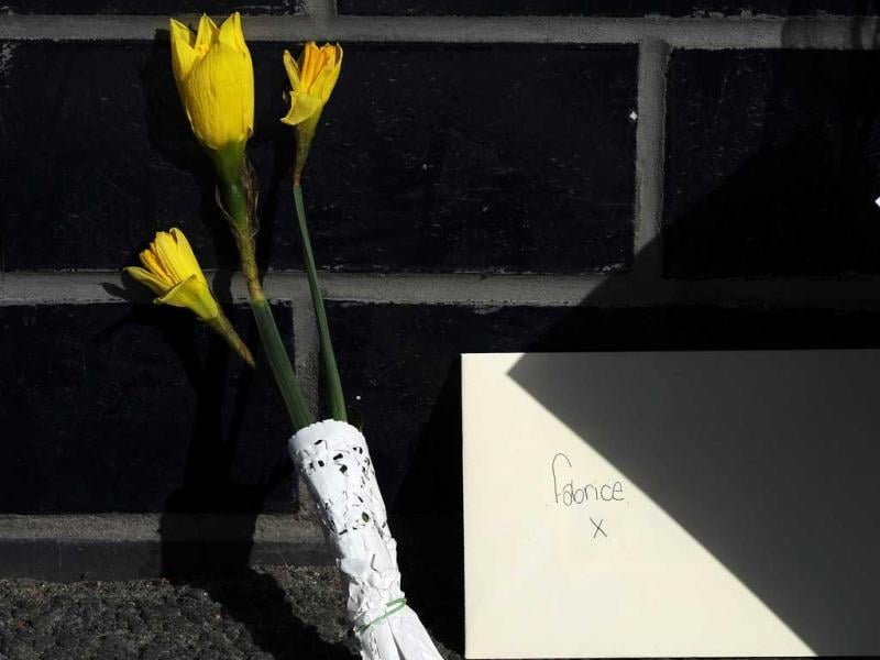 A card and flowers from a well-wisher to Fabrice Muamba are seen at the Reebok stadium in Bolton, northern England. Reuters/Nigel Roddis
