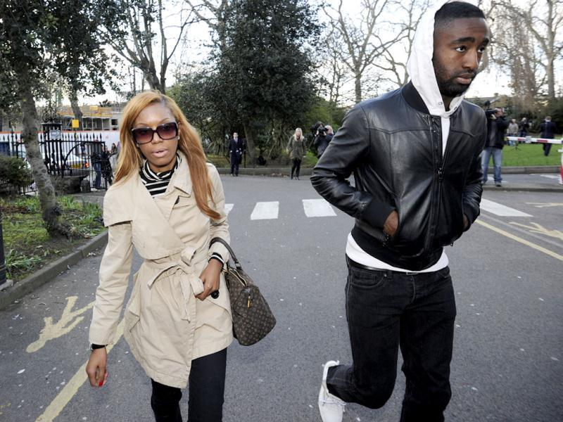 Arsenal soccer player Johan Djourou (R) arrives at the London Chest Hospital in east London where Fabrice Muamba is admitted after suffering a cardiac arrest on Saturday. Reuters/Paul Hackett