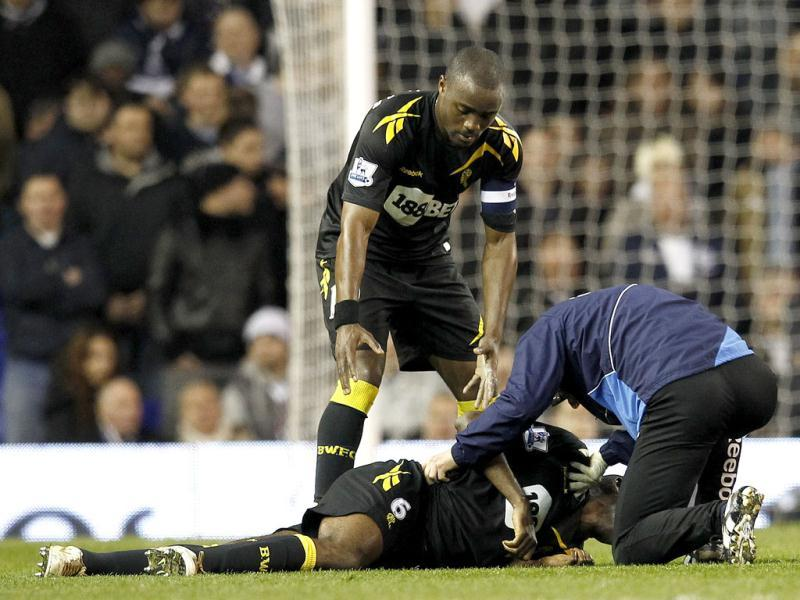 Bolton Wanderers' Nigel Reo-Coker helps a member of the club's medical staff attend to Fabrice Muamba after he collapsed on the pitch during their FA Cup quarter-final soccer match against Tottenham Hotspur at White Hart Lane in London. Reuters/Suzanne Plunkett