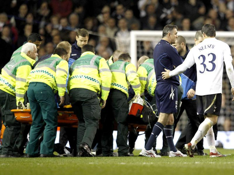 Tottenham Hotspur's Ryan Nelsen (R) puts his arm around Bolton Wanderers' manager Owen Coyle after Bolton Wanderers' Fabrice Muamba collapsed. The match was abandoned after Muamba collapsed near the centre circle. Reuters/Suzanne Plunkett