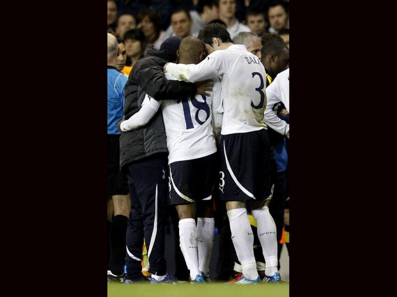 Tottenham Hotspur's Jermain Defoe and teammate Gareth Bale embrace after Bolton Wanderers' Fabrice Muamba was taken off the field during their FA Cup quarter-final match at White Hart Lane. Reuters/Suzanne Plunkett