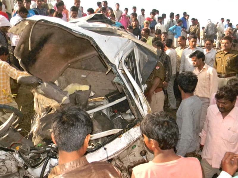 Police and bystanders are seen gathered near the mangled wreckage of a vehicle following a collision with a train and a jeep, in which fifteen people were killed, at Mahamaya Nagar district in Uttar Pradesh. AFP photo