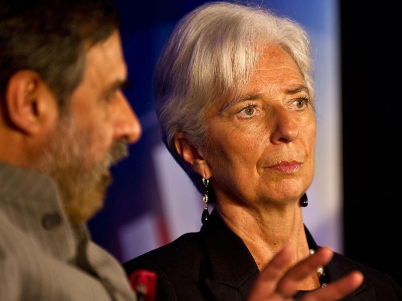 International Monetary Fund managing director Christine Lagarde (R) listens to minister of commerce and industry Anand Sharma during an IMF-backed conference on 'Sustaining a High-Quality Growth' in the economies of India and China, in New Delhi. AFP/Manan Vatsyayana