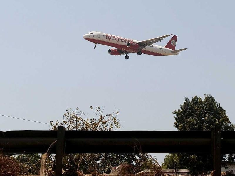 A Kingfisher Airlines Airbus A321 aircraft makes its final approach for landing at the Chatrapati Shivaji International Airport in Mumbai. Shares in the beleaguered Airlines tumbled close to a record low on fears that the debt-laden carrier could lose its flying licence. AFP/Punit Paranjpe