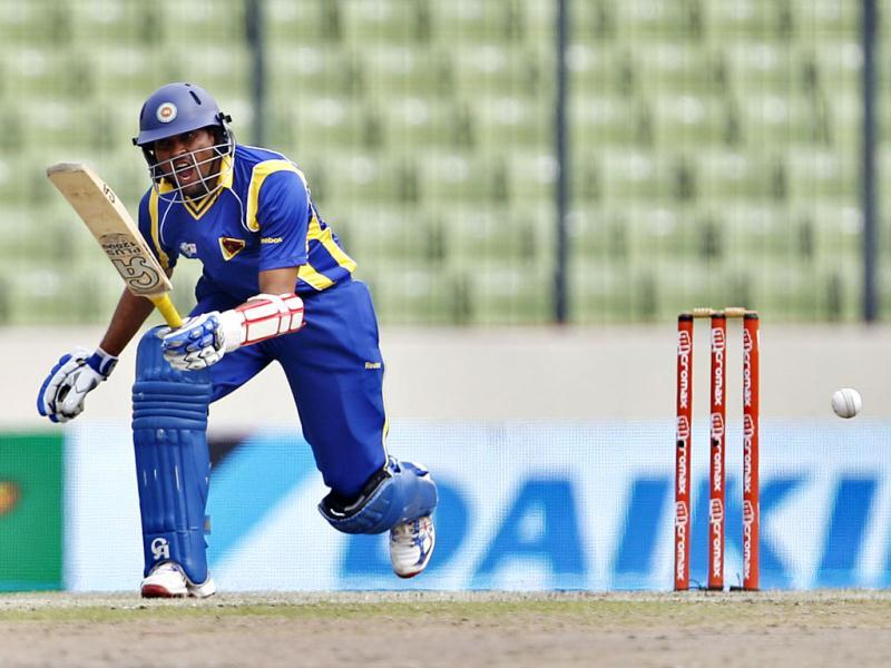 Sri Lanka's Tilakaratne Dilshan reacts after playing a shot during their Asia Cup cricket match against Bangladesh in Dhaka, Bangladesh. (AP Photo/Aijaz Rahi)