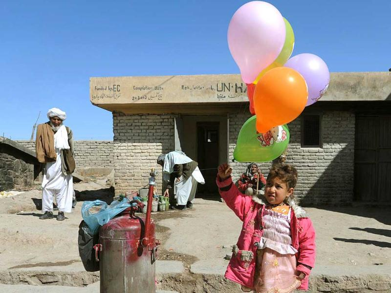 An Afghan girl holds balloons during celebrations of Nowruz, the Afghan new year in Herat. AFP Photo/ Aref Karimi
