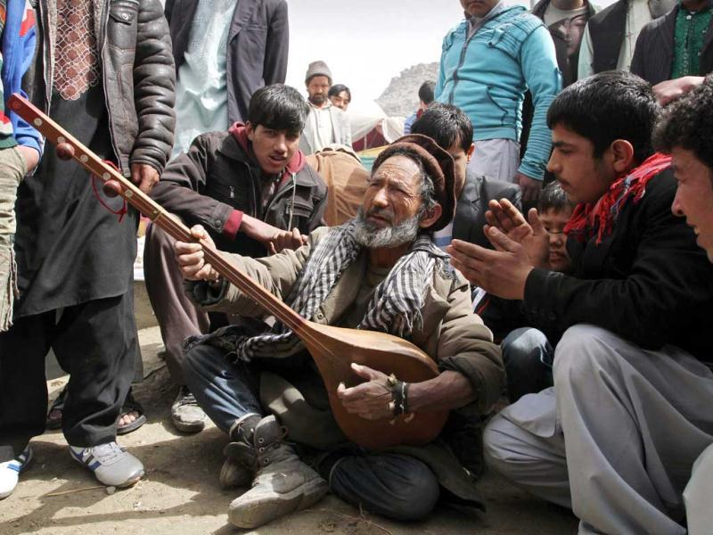 An Afghan musician plays an instrument called a dombura at a celebration of the Persian New Year Nowruz in Kabul. AP Photo/Musadeq Sadeq