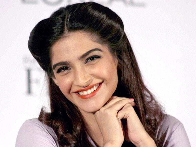 Bollywood actor Sonam Kapoor is all smiles during the unveiling of the L'Oreal Paris Femina Women Award 2012. (Photo: PTI)