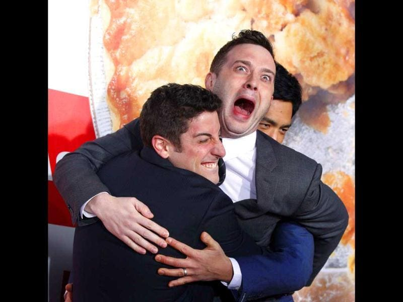 Cast members Jason Biggs and Eddie Kaye Thomas gesture at the premiere. (Reuters Photo)