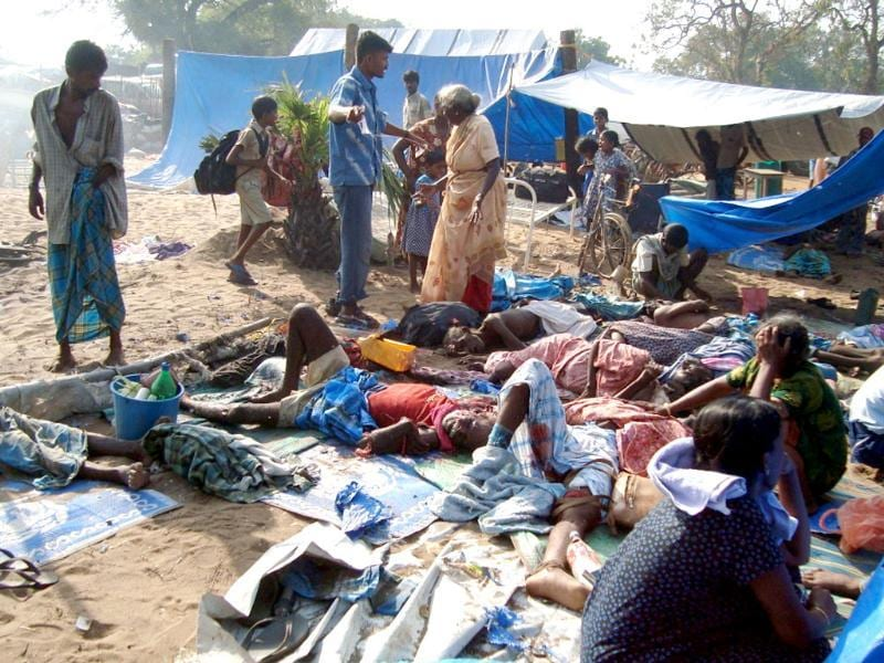 File photo: A picture supplied by the pro-rebel group www.Tamilnet.com shows what they say are dead and injured Tamil civilians after a mortar attack on May 12, 2009 at a makeshift hospital inside the