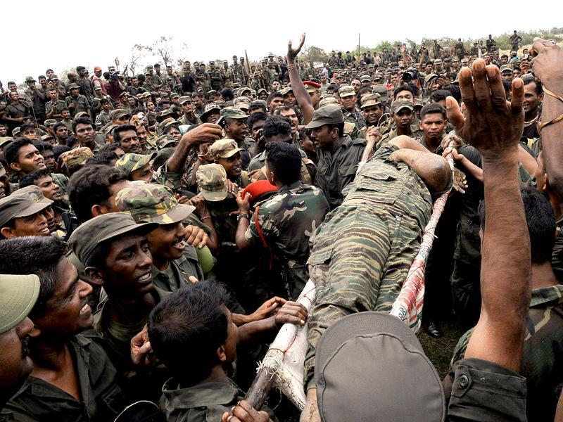 File photo: The body of Liberation Tigers of Tamil Eelam leader Vellupillai Prabhakaran is carried on a stretcher through a group of Sri Lankan soldiers at Nanthikadal lagoon, near the town of Mullaittivu in northern Sri Lanka on May 19, 2009. Reuters