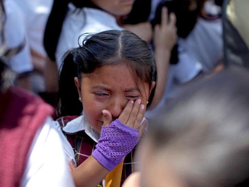 A child cries after she and her classmates were evacuated from her school in the Roma neighborhood when an earthquake was felt in Mexico City. AP Photo/Alexandre Meneghini