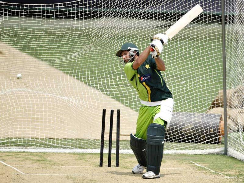 Pakistan's Shahid Afridi bats in the nets during a training session in Dhaka, Bangladesh. AP Photo/Aijaz Rahi.