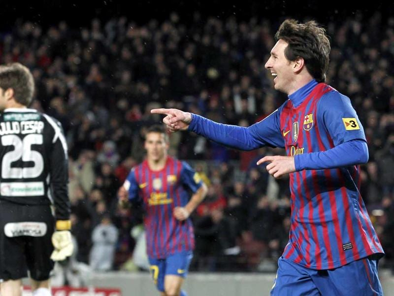 Lionel Messi celebrates his third goal against Granada during their Spanish First division soccer match at Camp Nou stadium in Barcelona. Reuters/Albert Gea