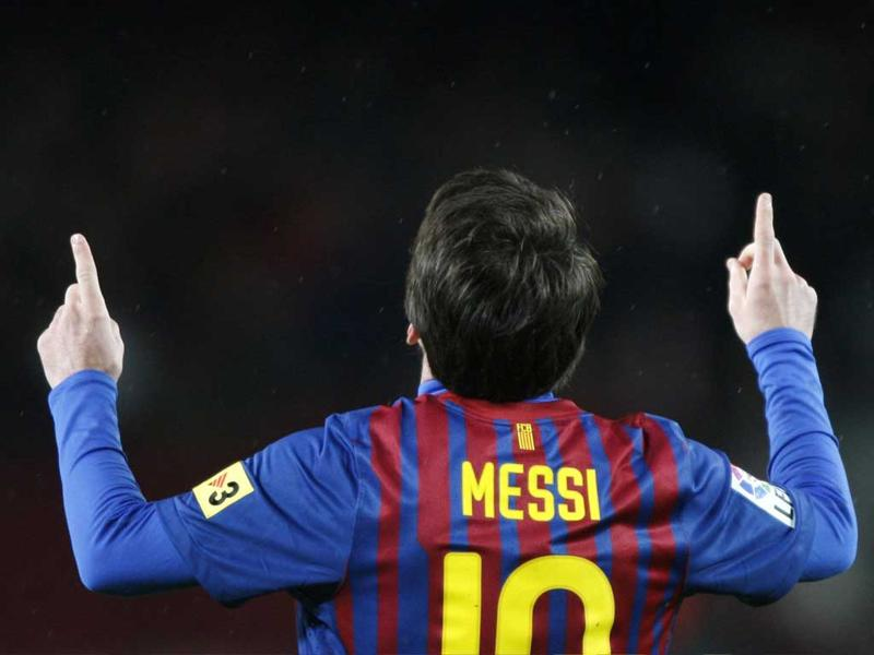 Lionel Messi celebrates scoring his second goal during their Spanish First division soccer match against Granada at Camp Nou stadium. Messi set a Barcelona scoring record of 233 goals when he netted his second of the night. Reuters/Albert Gea