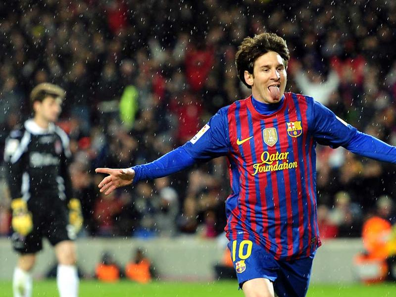 FC Barcelona's Lionel Messi, from Argentina, reacts after scoring against Granada during a Spanish La Liga soccer match at the Camp Nou stadium in Barcelona, Spain, Tuesday. AP Photo/Manu Fernandez