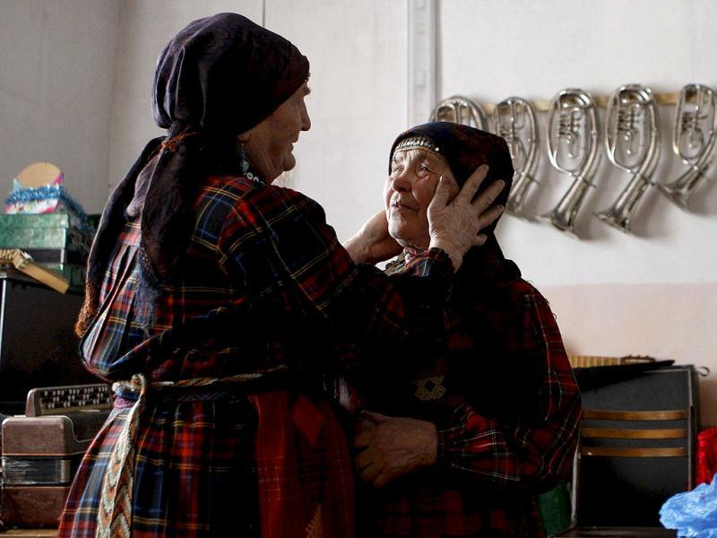 Zoya Dorodova, 72, and Galina Konyeva, 74, members of the singing group