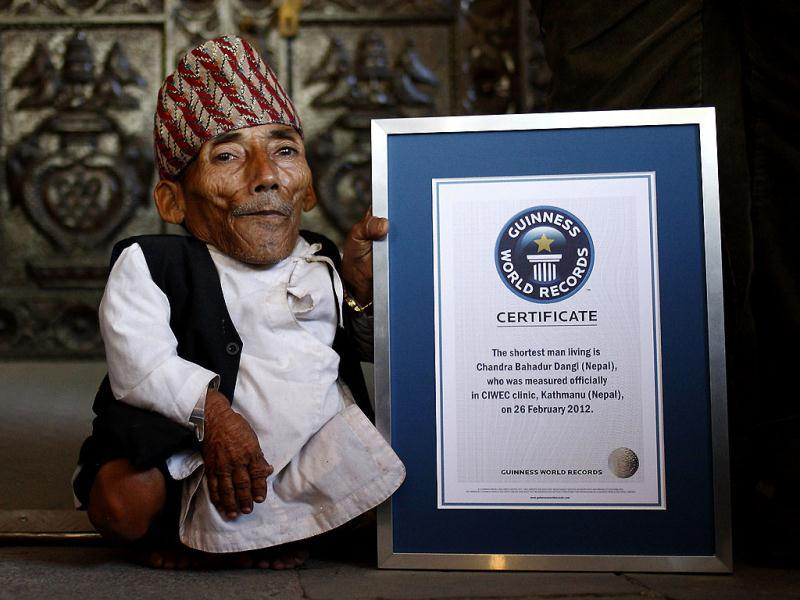 Chandra Bahadur Dangi, 72, poses for a picture with his certificate after being announced as the world's shortest man living, as well as shortest person ever measured by the Guinness World Records, in Kathmandu on February 26, 2012. Dangi was measured at 21.5 inches (54.60cm), beating former record holder Junrey Balawing of the Philippines, who stands at a height of 23.5 inches (60 cm). Reuters/Navesh Chitrakar