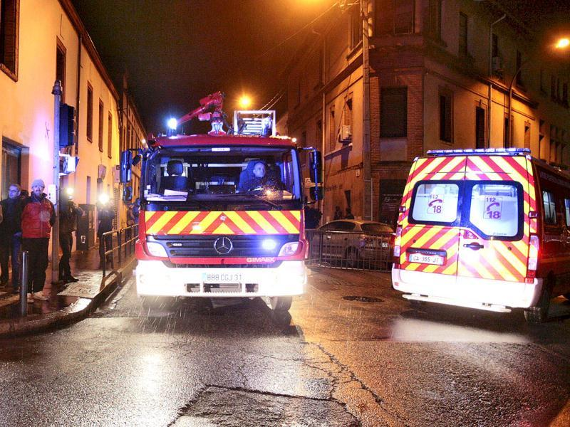 Emergency services trucks block a street during a raid on a house to arrest suspects in the killings of three children and a rabbi on Monday at a Jewish school, in Toulouse. Reuters/Pascal Parrot