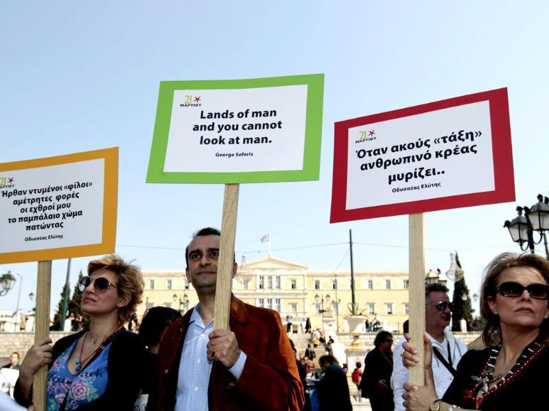 Protesters hold placards with poems during an anti-austerity rally in Athens. Reuters/Yorgos Karahalis