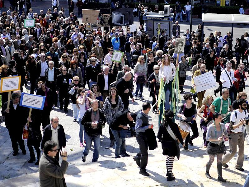Musicians and artists take part in a demonstration by Greek poets and artists marking World Poetry Day. The artists marched in central Athens demonstrating against the financial crisis and the governments austerity measures. AFP Photo/Louisa Gouliamaki