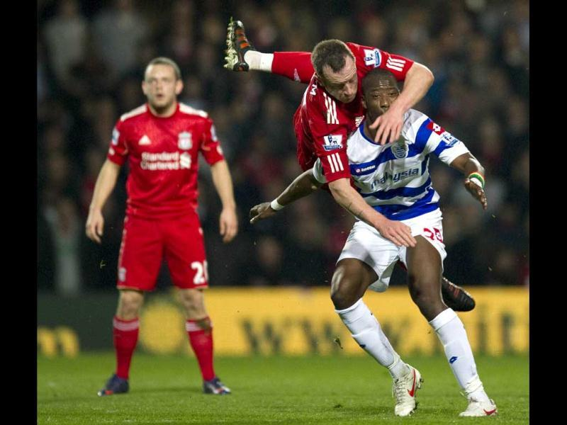 Liverpool's Scottish midfielder Charlie Adam vies with Queens Park Rangers' French-Malian midfielder Samba Diakite during the English Premier League football match between Queens Park Rangers and Liverpool at Loftus Road in London. (AFP Photo)