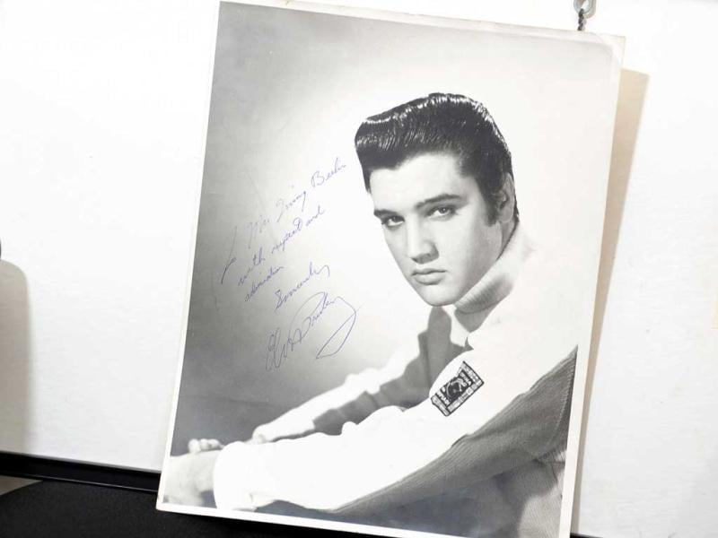 An original photograph of Elvis Presley autographed and inscribed to songwriter and compose Irving Berlin on auction at Gotta Have It! store in New York City. (Michael Loccisano/Getty Images/AFP)