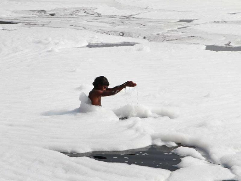 River Yamuna has become unrecognisable with a constant layer of foam on its surface. HT Photo/Mohd Zakir
