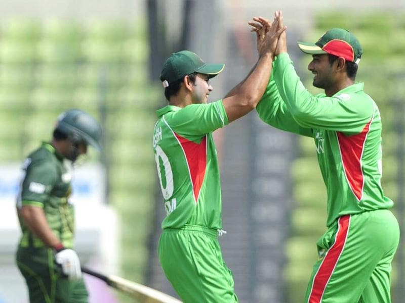 Bangladeshi cricketer Mohammad Mahmudullah celebrates with his teammate Nazim Uddin after the dismissal of Pakistani batsman Nasir Jamshed during the one day international Asia Cup cricket final match at The Sher-e-Bangla National Cricket Stadium in Dhaka. AFP/Munir uz Zaman