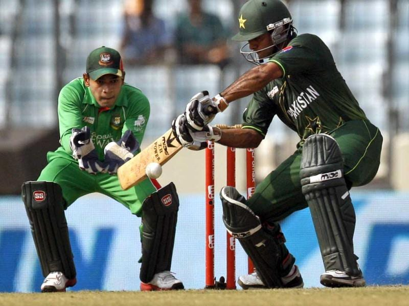 Bangladeshi wicketkeeper Mushfiqur Rahim watches as Pakistan's Mohammad Hafeez Khan plays a shot during their Asia Cup final cricket match in Dhaka. AP/Pavel Rahman
