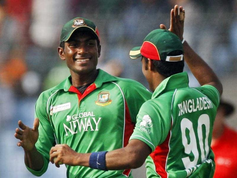 Bangladesh's Jahurul Islam, left, celebrates with teammate Nazmul Hossain the dismissal of Pakistan's Mohammad Hafeez during their Asia Cup cricket match in Dhaka, Bangladesh. AP/Pavel Rahman