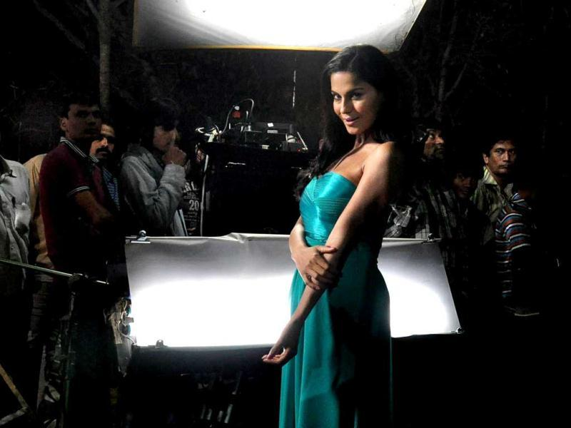 Veena posed in a teal sheen gown.