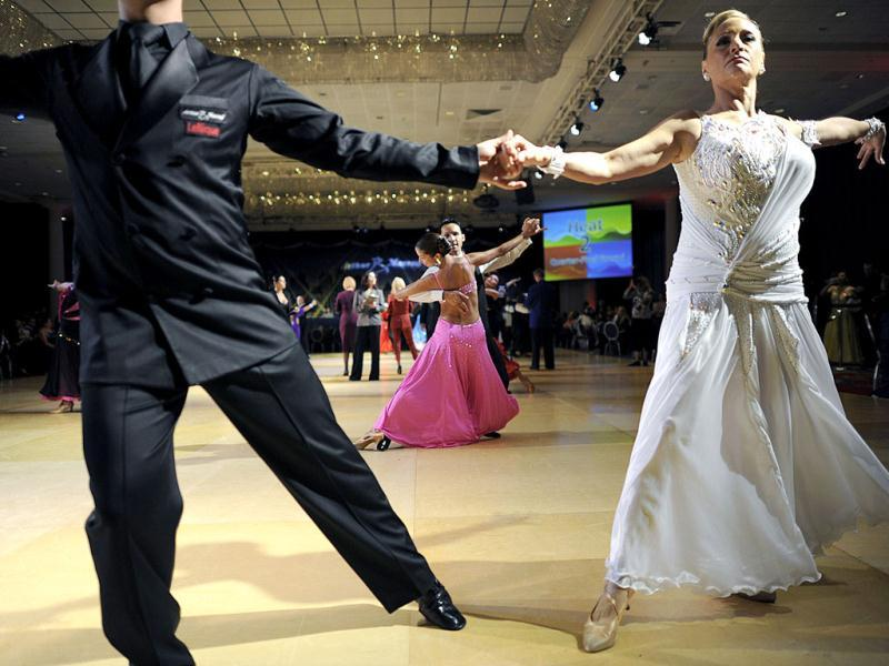 Dancers celebrate the 100th year of Arthur Murray Ballroom Dance Studios for social and competitive ballroom dancing around the world. AFP/Timothy A Clary