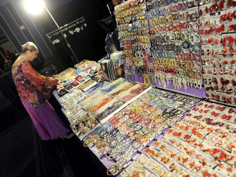 Dancer Mary Ellen Westlie from Coloradolooks at the jewellery centre before the first round in the Closed Smooth category during the Arthur Murray International 2012 World Dance-O-Rama in New York. AFP/Timothy A Clary