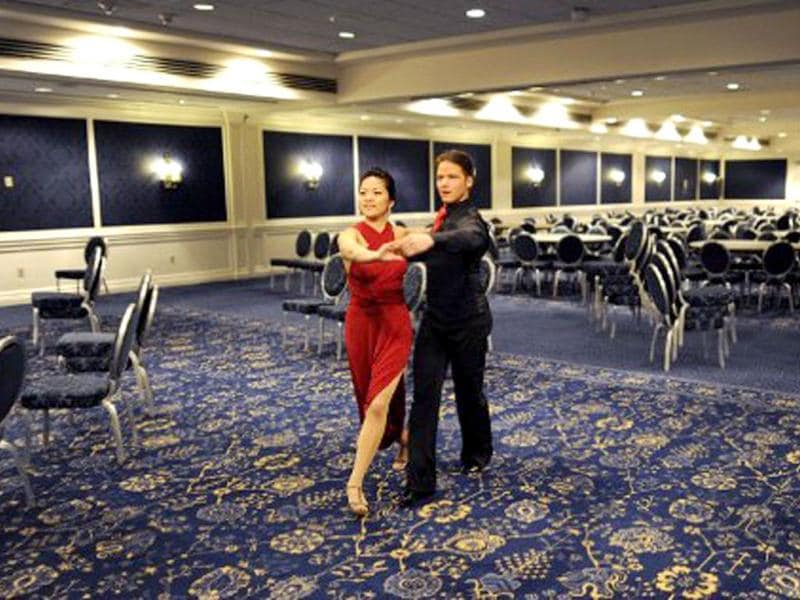 Dancers Sooyeeon Ahn and Boris Vdovine pratise in a spare ballroom after the first round in the Closed Smooth category during the Arthur Murray International 2012 World Dance-O-Rama in New York. AFP/Timothy A Clary