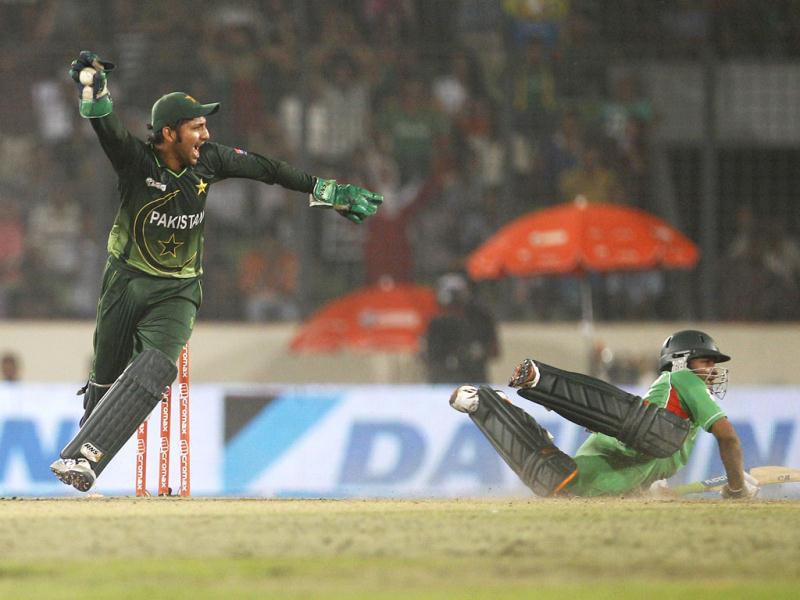 Pakistan wicketkeeper Sarfraz Ahmed, left, appeals unsuccessfully for the run-out of Bangladesh's Shakib Al Hasan during their Asia Cup final cricket match in Dhaka. AP/Aijaz Rahi