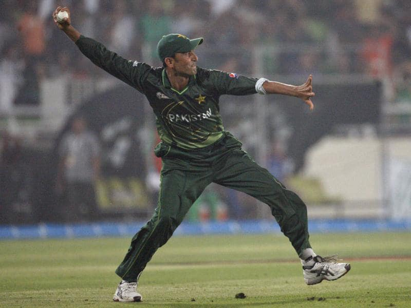 Pakistan's Younis Khan throws the ball after dismissing Bangladesh's Nazimuddin during their Asia Cup cricket match final in Dhaka, Bangladesh. AP/Pavel Rahman