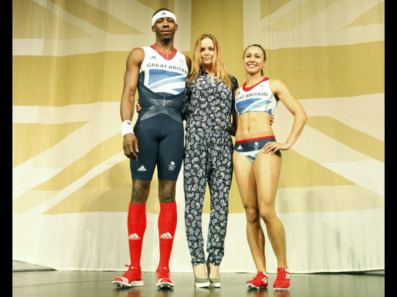 Triple jumper Phillips Idowu (L) and heptathlete Jessica Ennis pose wearing the new Team GB kits designed by British designer Stella McCartney (C) for the London 2012 Olympic Games, in London. Reuters/Andrew Winning