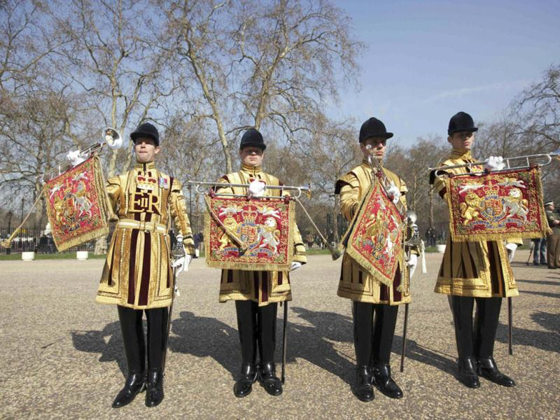 State trumpeters of the Household Cavalry are seen dressed in their summer uniforms, during a media viewing at Wellington Barracks showing uniforms that will be worn for the Queen's Diamond Jubilee celebrations, London. Reuters/Olivia Harris