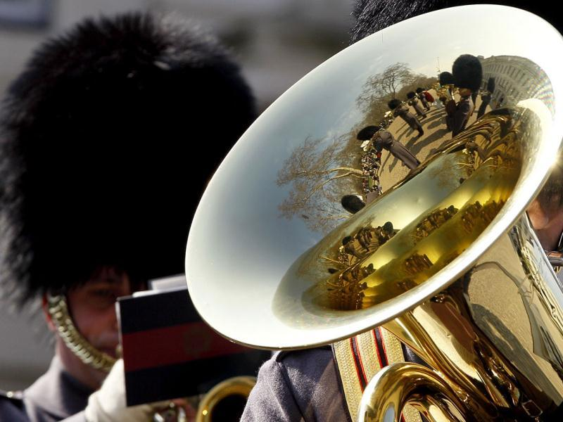 A soldier of the Scots Guard band plays during a media facility at Wellinton Barracks in London. Details of the Military personnel and uniforms to be used at the Queen's Diamond Jubilee in June were announced. AP Photo/Kirsty Wigglesworth