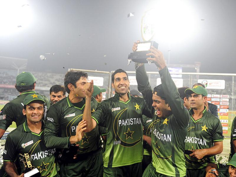 Pakistan cricketer Umar Akmal lifts the trophy following the one day international Asia Cup cricket final match against Bangladesh at The Sher-e-Bangla National Cricket Stadium in Dhaka. AFP/Munir uz Zaman